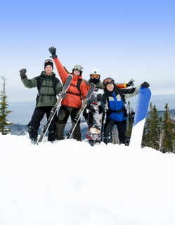 snowboarders and skiers on mountain