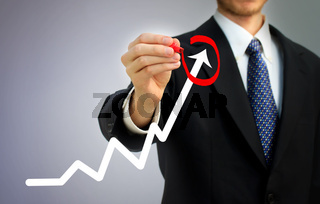 Businessman circling a rising arrow