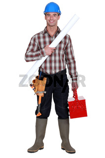craftsman holding a blueprint and a toolbox