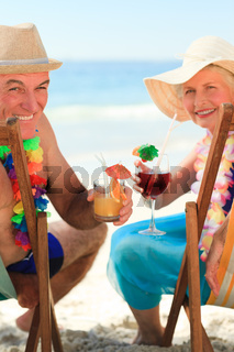 Happy senior couple drinking a cocktail