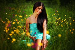 beautiful woman on flower field