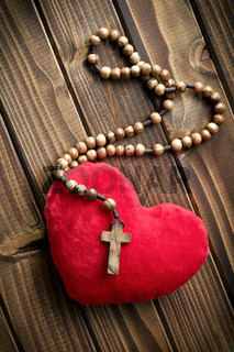 furry heart with rosary beads