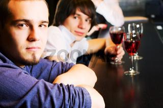 Young men relaxing at a bar counter