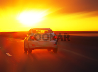 car at sunset on the highway