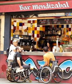 People in invalid prams, street bar.