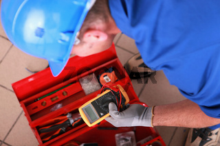 Man with electricity measurer