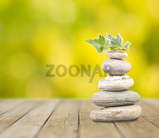 Stack pebbles on wooden table