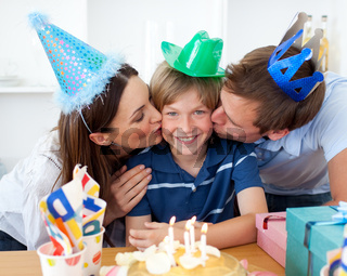Close-up of parents celebrating their son's birthday