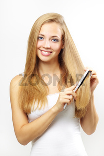 girl combing of her hair. on gray