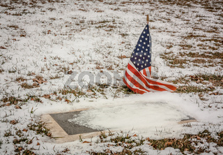 Veteran's Grave in a Rural American Cemetery in Winter