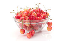 ripe cherry in bowl isolated on white
