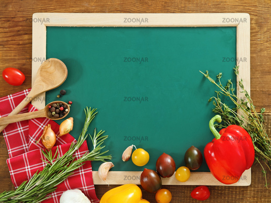 Vegetables still life with green board