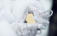 Close-up of the lock in hand bride