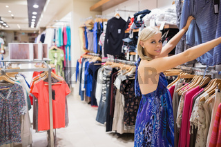 Woman looking through clothes at the boutique