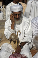 Omani man makingwith a cellular phone, Oman