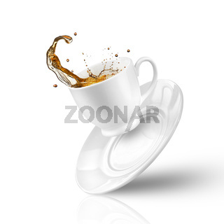 Splash of tea in the falling cup isolated on white