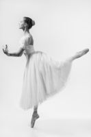 The beautiful ballerina dances on the tips of the