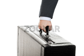 Hand holding suitcase