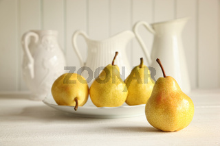 Fresh pears on wooden table