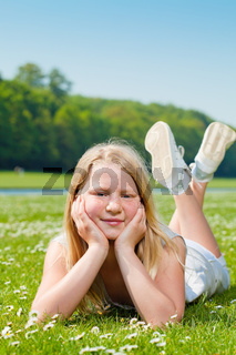 Teenager girl lying on the grass