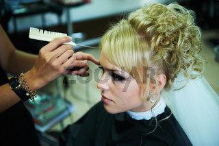 Bride for the wedding in the barbershop