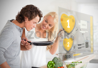 Couple preparing dinner using futuristic interface