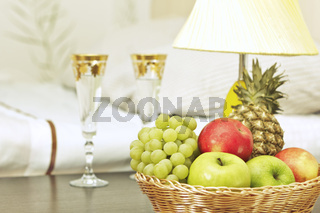 Fruit and glasses on table in interior