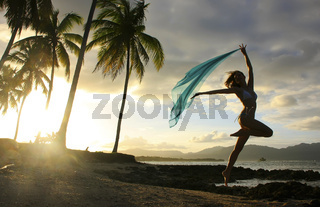 Silhouette of young woman jumping at Las Galeras beach