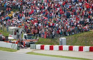 BARCELONA- MAY 9: The racing car take off from line in sandy zone during The Formula 1 Grand Prix at autodrome 'Catalunya Montmello' on May 9
