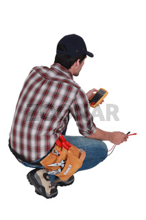Electrician taking electrical reading