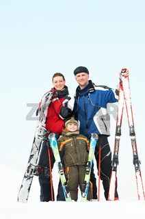 Happy sporty family at winter