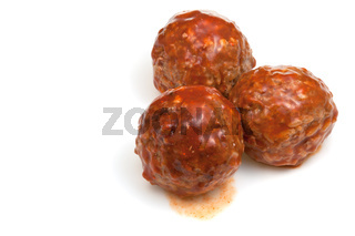 portion roasted meatballs under meat sauce