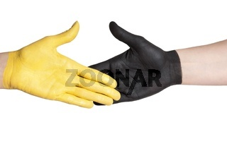 a handshake between a yellow and a black painted hand