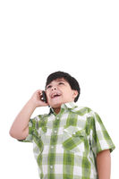 boy  laughs and talks by mobile phone.