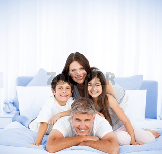 Happy family portrait in bed