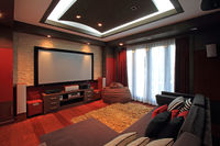 Theater room in luxury home with wide screen
