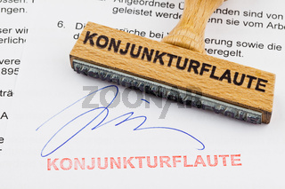 Holzstempel auf Dokument: Konjunkturflaute