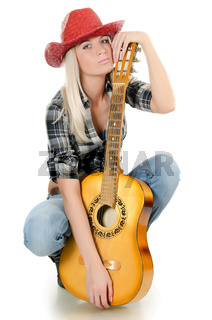 The beautiful girl in a cowboy's hat isolated