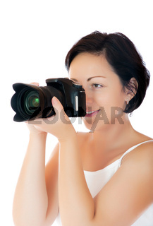 Young woman with DSLR isolated