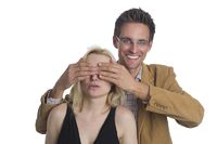 Surprise man holds a woman's eyes