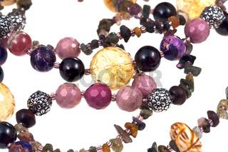 fragment gemstone lady's bead closeup isolated on white
