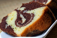Slices of homemade marble cake on a white plate wi