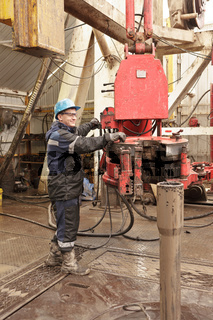 Worker in rig floor