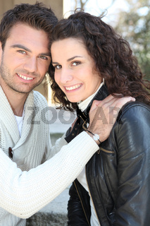 Young couple smiling outdoors