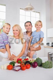 Smiling parents bearing their offspring
