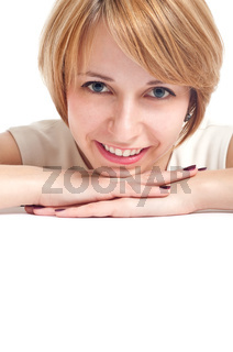 portrait of a smiling girl with blue eyes with white copy-space