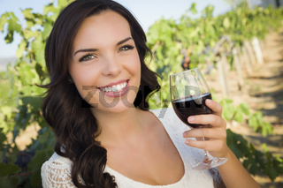 Young Adult Woman Enjoying A Glass of Wine in Vineyard
