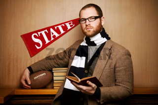 Young college man with books & ball