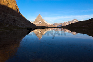 Matterhorn reflecton in Riffelsee after sunset, Zermatt, Alps, Switzerland