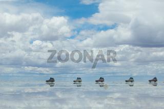 jeep in the salt lake salar de uyuni, bolivia